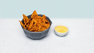 Bowl of seasoned tortilla chips with habanero flavour and cheese sauce