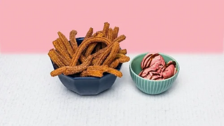 Bowl of churros with a small bowl of strawberry ice cream