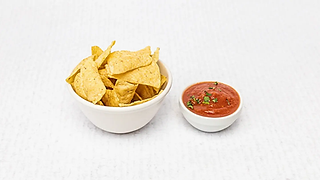 Small nachos in a bowl served with salsa