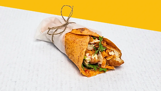 Chicken wrap with home-made nuggets wrapped in a paper