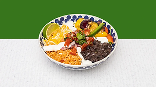 Burrito Bowl full of rise, beans, cheese, grilled vegetables