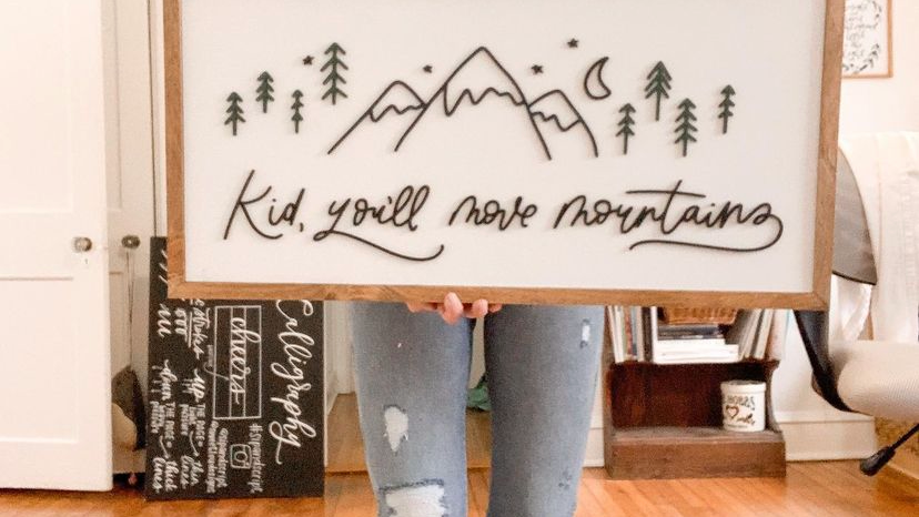 Kid You'll Move Mountains sign