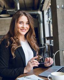 widely-smiling-businesswoman-working-lap