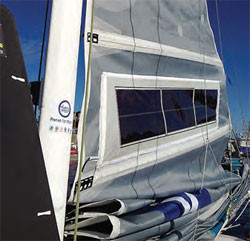 the mainsail goes up on Daniel Ecalard's Open 50 ahead of the rough 2014 Route du Rhum, during which her solar installation performed flawlessly