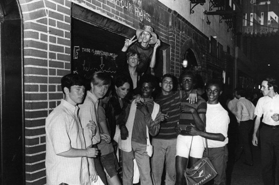 1960s people posing in front of Stonewall Inn