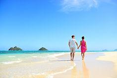 Beach honeymoon couple holding hands wal