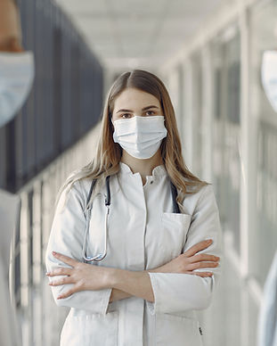 woman-in-white-coat-wearing-white-face-m