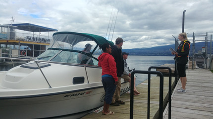 Sierra talking to boaters at Gellatly boat launch