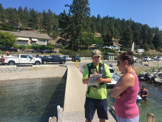 Connor interacting with boaters at Okanagan Centre Safe Harbour