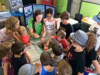 Sam teaching kids how to clean, drain, dry