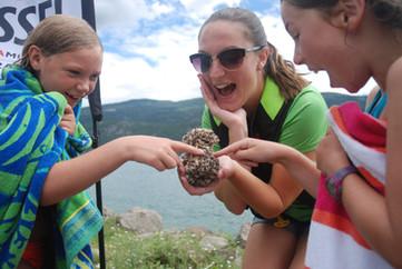 Sam showing kids invasive mussels