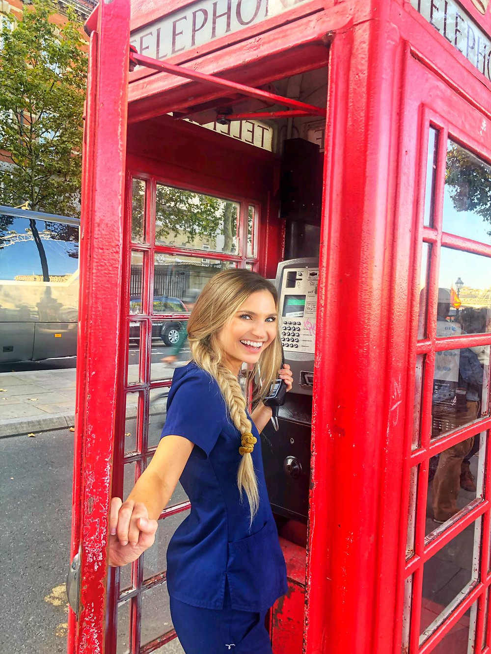 travel nurse and lifestyle blogger kirsten conrad in a phone box