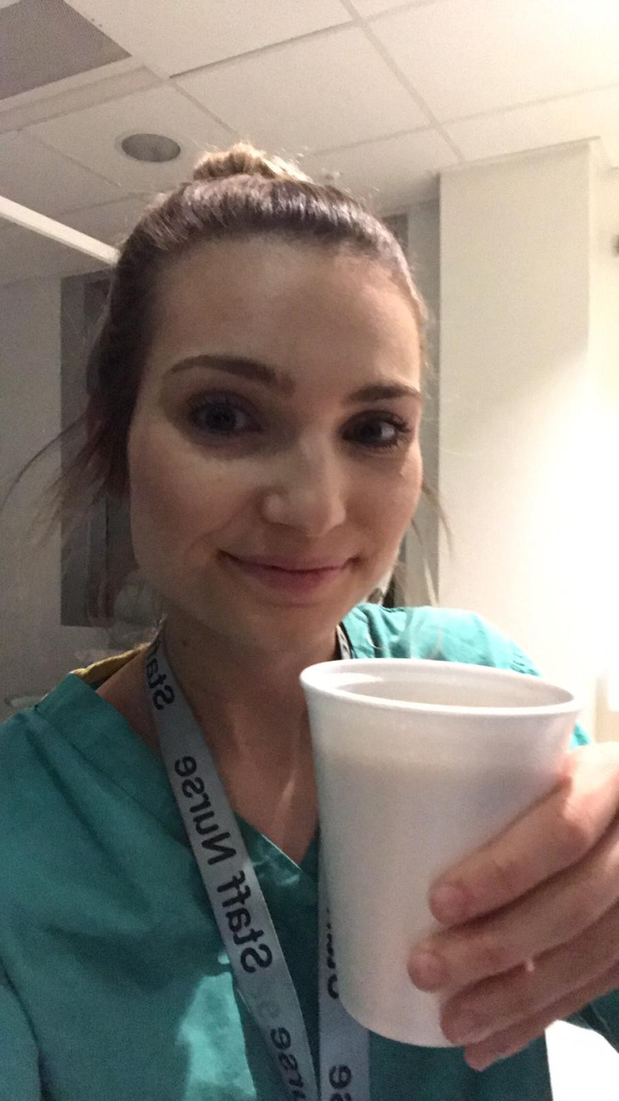 travel nurse and lifestyle blogger kirsten conrad drinking coffee