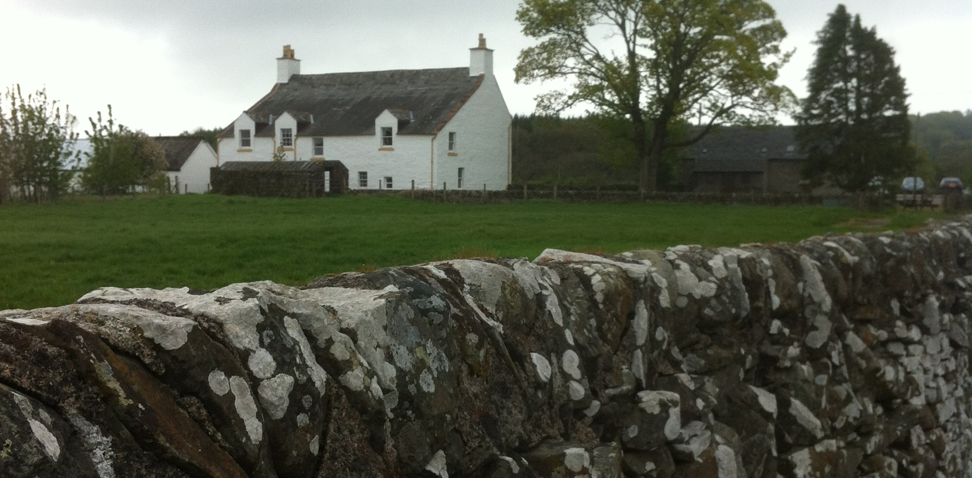 Scottish cottage and stone wall