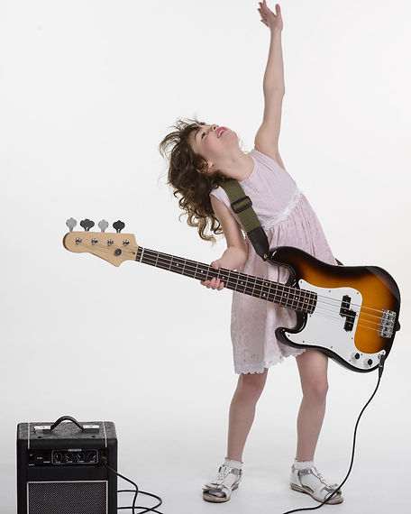 Young lady is looking upwards with rised hand and head.jpgProfessional bass guitar connect