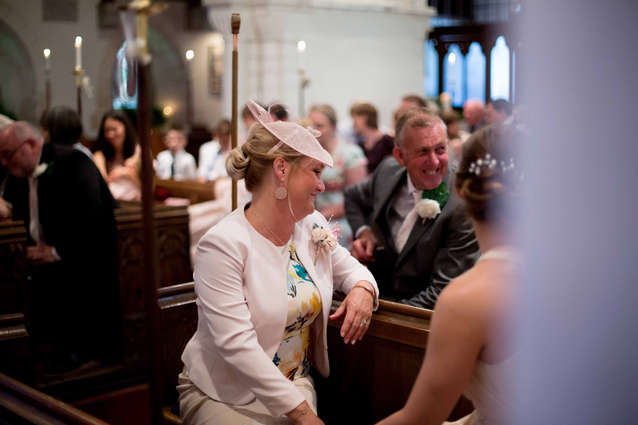 Proud mother of bride sitting in church