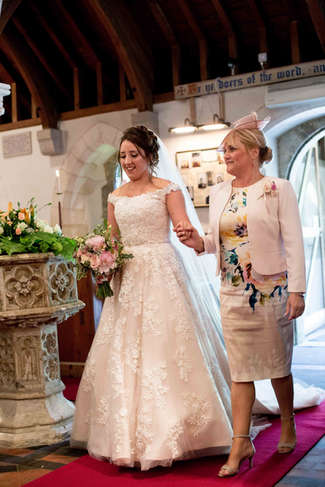 Natural wedding photography of bride and mother