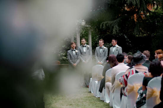 Artistic wedding photography of groom waiting for bride at ceremony