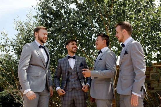 Natural wedding photography of groomsman