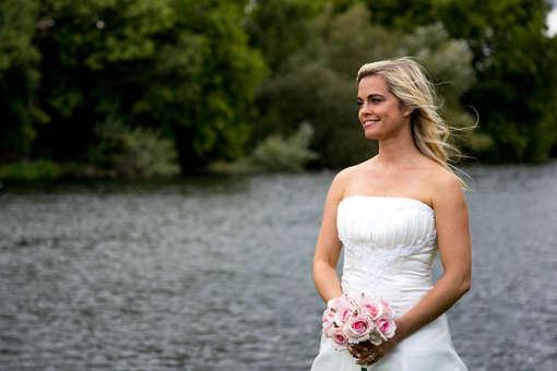 Wedding bridal portrait of bride beside lake