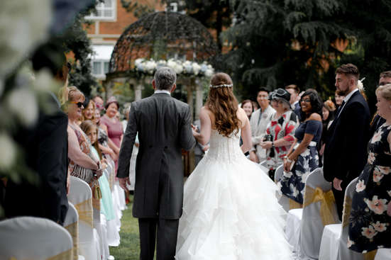 Photography of Bride walking down isle with her proud father