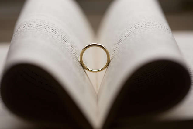 Closeup photo of wedding rings on book