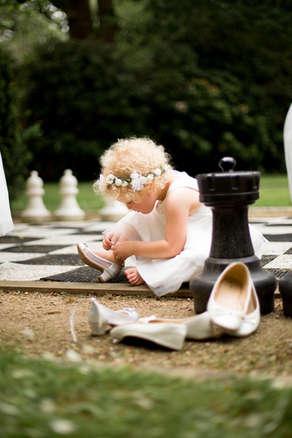 Reportive wedding photography of flower girl
