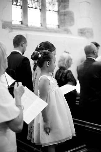 Cute child watcing wedding ceremony in church