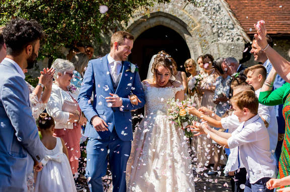 Colourful confetti photo of newly married couple