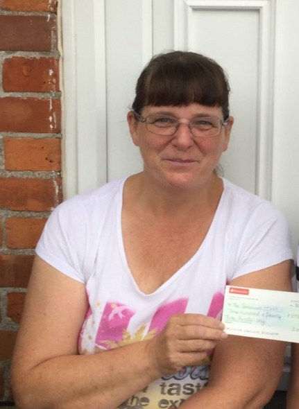 Cynthia Martin with cheque  June 2018.jp