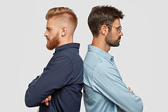 indoor-view-serious-two-partners-stand-back-have-some-disagreement-keeps-hands-folded.jpg