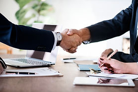 business-people-shaking-hands-together (1).jpg