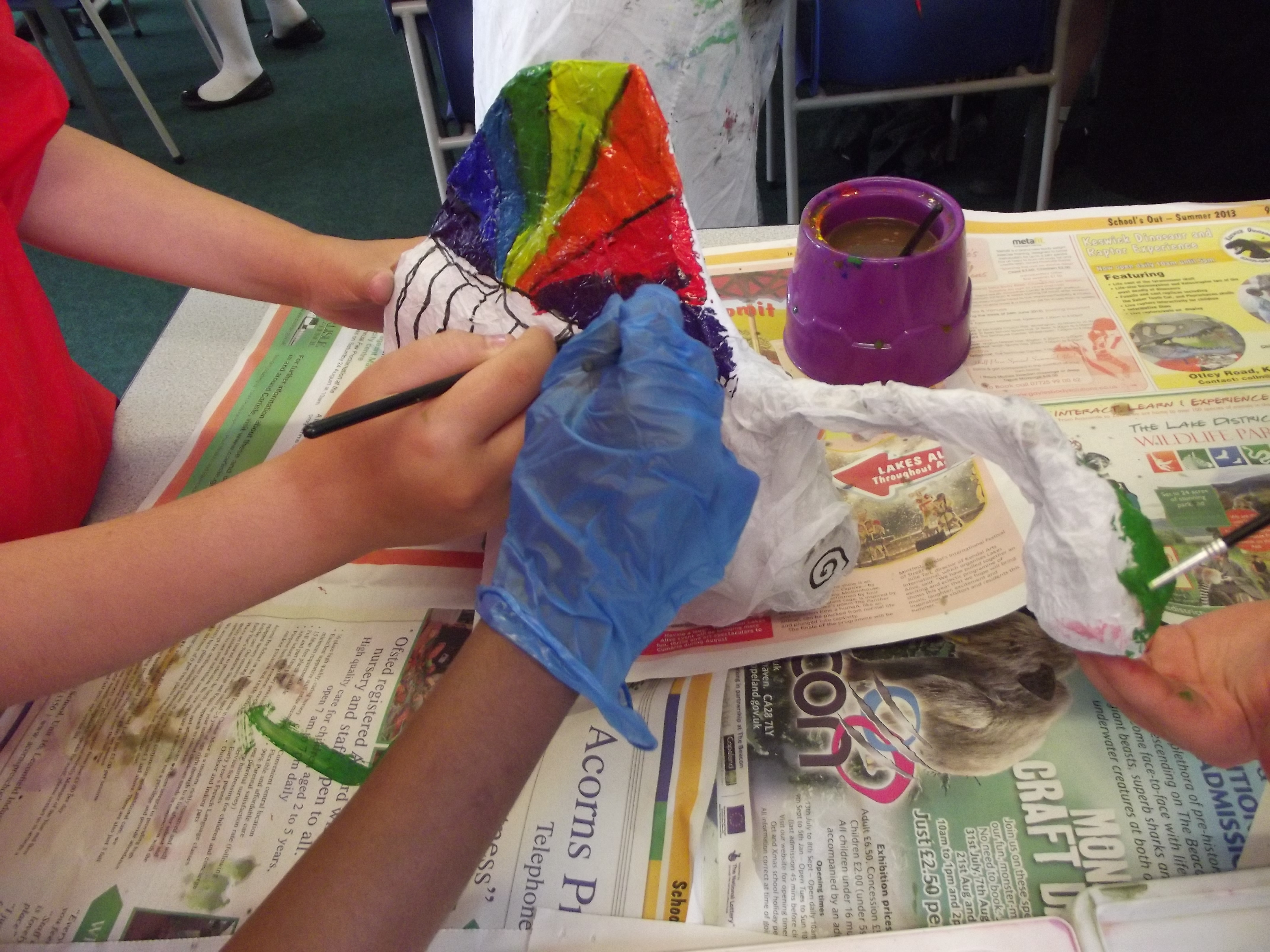 Painting a fish puppet
