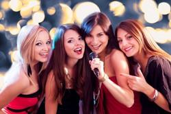four_beautiful_women_singing