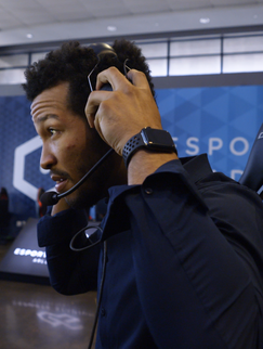 Jaylon putting on headset in gaming cent