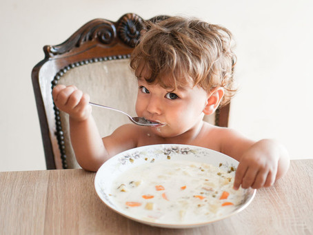 What age should a child be out of a high chair?