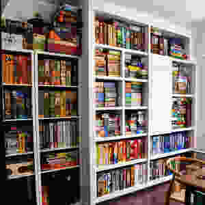 The sign of a true board gamer, a wallful of of shelves stacked with board games