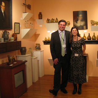 In addition to setting up in fields and at Bottle Shows, Holly and I also display our wares at antique shows where we (gasp!) can sometimes be seen wearing dress attire.  We greatly enjoy mixing bottles and glass in with other period decorative arts.
