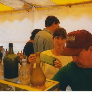 We traveled extensively to both auctions and shows through the mid and late 90s, continually upgrading our knowledge and meeting an increasing number of fellow collectors.  Holly is pictured here previewing bottles from the famed Ken Aldrich Collection in Sharon, Vermont.  Also included in the picture is noted dealer and raconteur Dave Webster (miss you Dave!!!) and our friend to this day, Chris Woods.