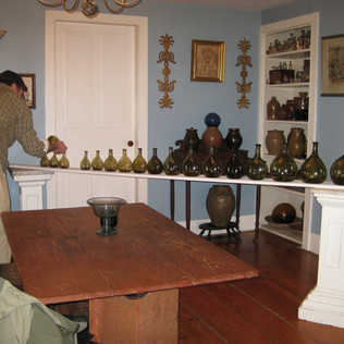 """Creating a """"run"""" of chestnut bottles is always a fun process, but it takes a very steady hand!"""