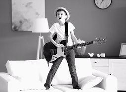 bigstock-Little-boy-playing-guitar-ans--