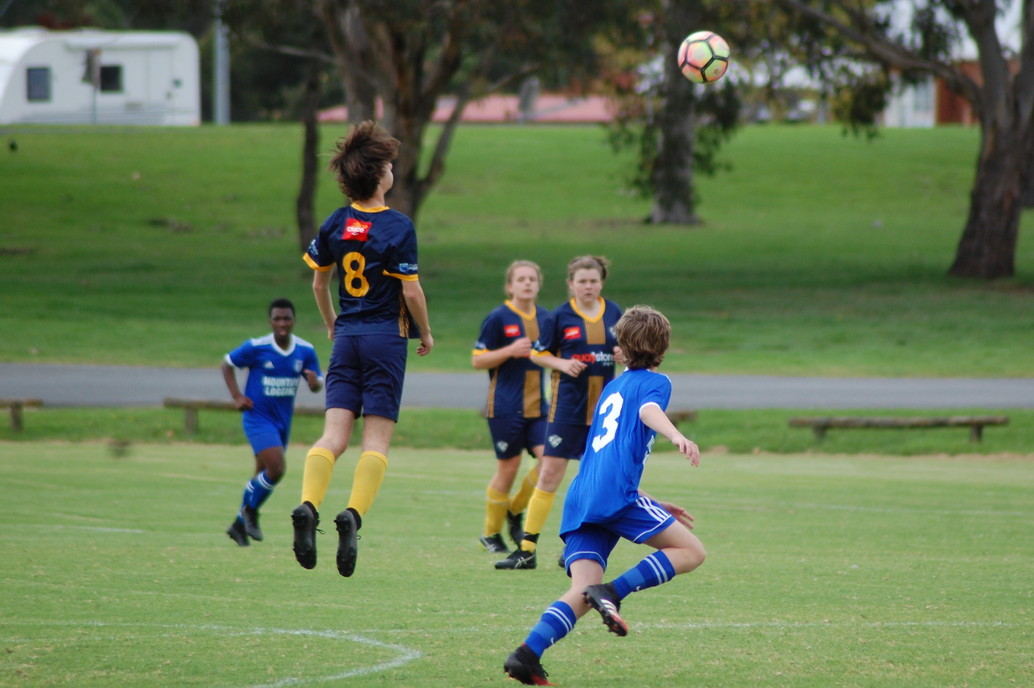 Noah Price takes flight for a header for