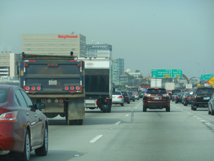 cars and trucks on a freeway in los angeles, california