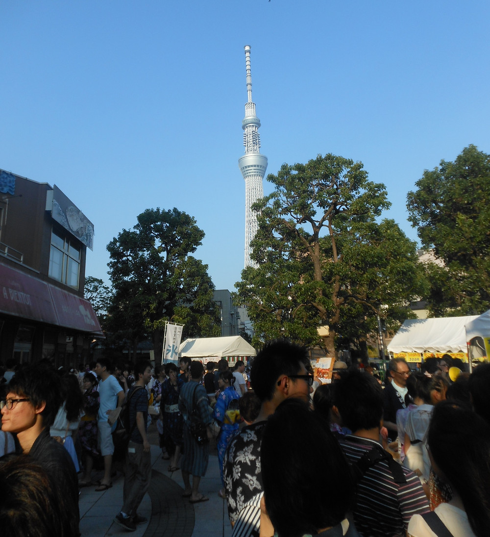 Tokyo Skytree towering over a crowd of people
