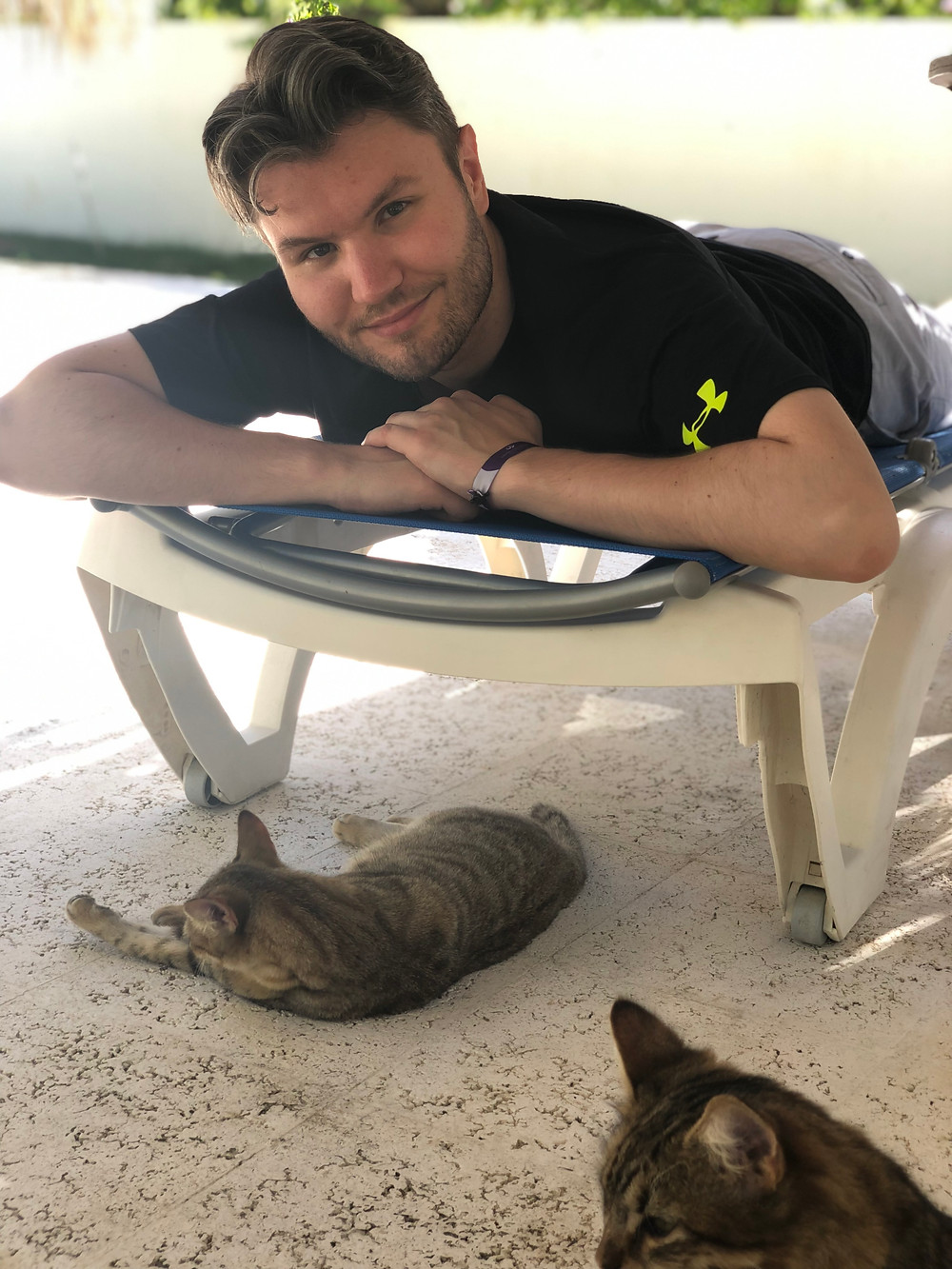 Petting Cats Near the Pool