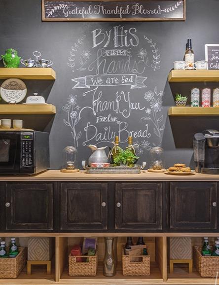 Farmhouse buffet and chalkboard wall.
