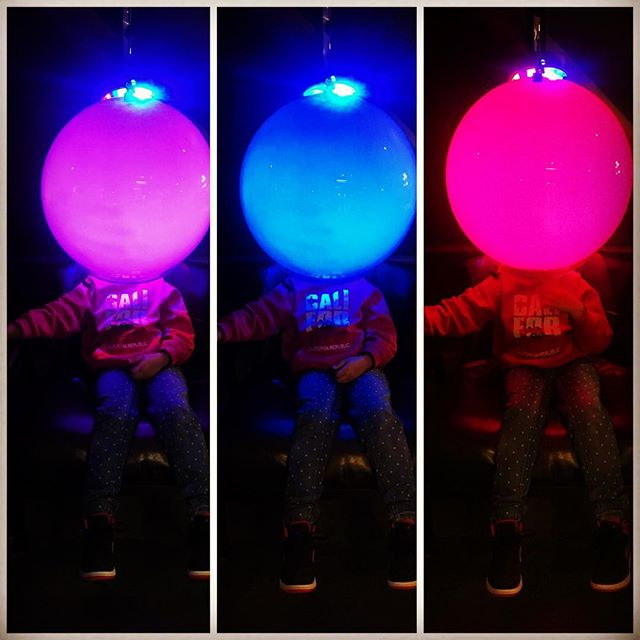 This experiment was about how different lighting effects your mood- I think Saty just liked having a giant ball on her head! #Exploratorium_