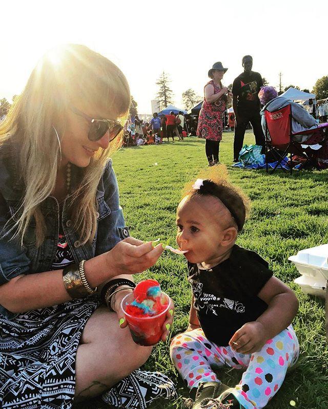 Ayala was thoroughly enjoying her refreshing treat at the Umoja Festival #Unity #UmojaFestival #Oakland #BayExplorers #BayArea #MomLife #Kid