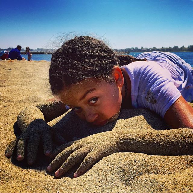 Just a tired sand monster! After we participated in coastal clean up day we stayed and played at the beach- this is literally how happy she_