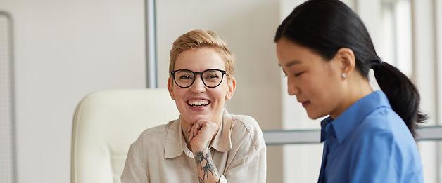 two-businesswomen-enjoying-work-4324V92_